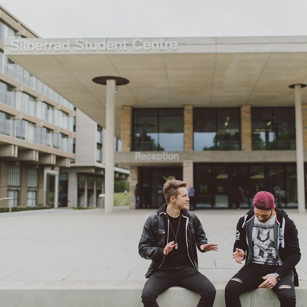 Students sitting outside student centre -essex